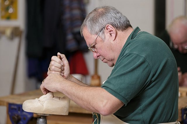 George palmer at work during a carve-in day at Portsmouth grammar school