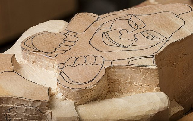 rough outline of work in progress carving of a gargoyle