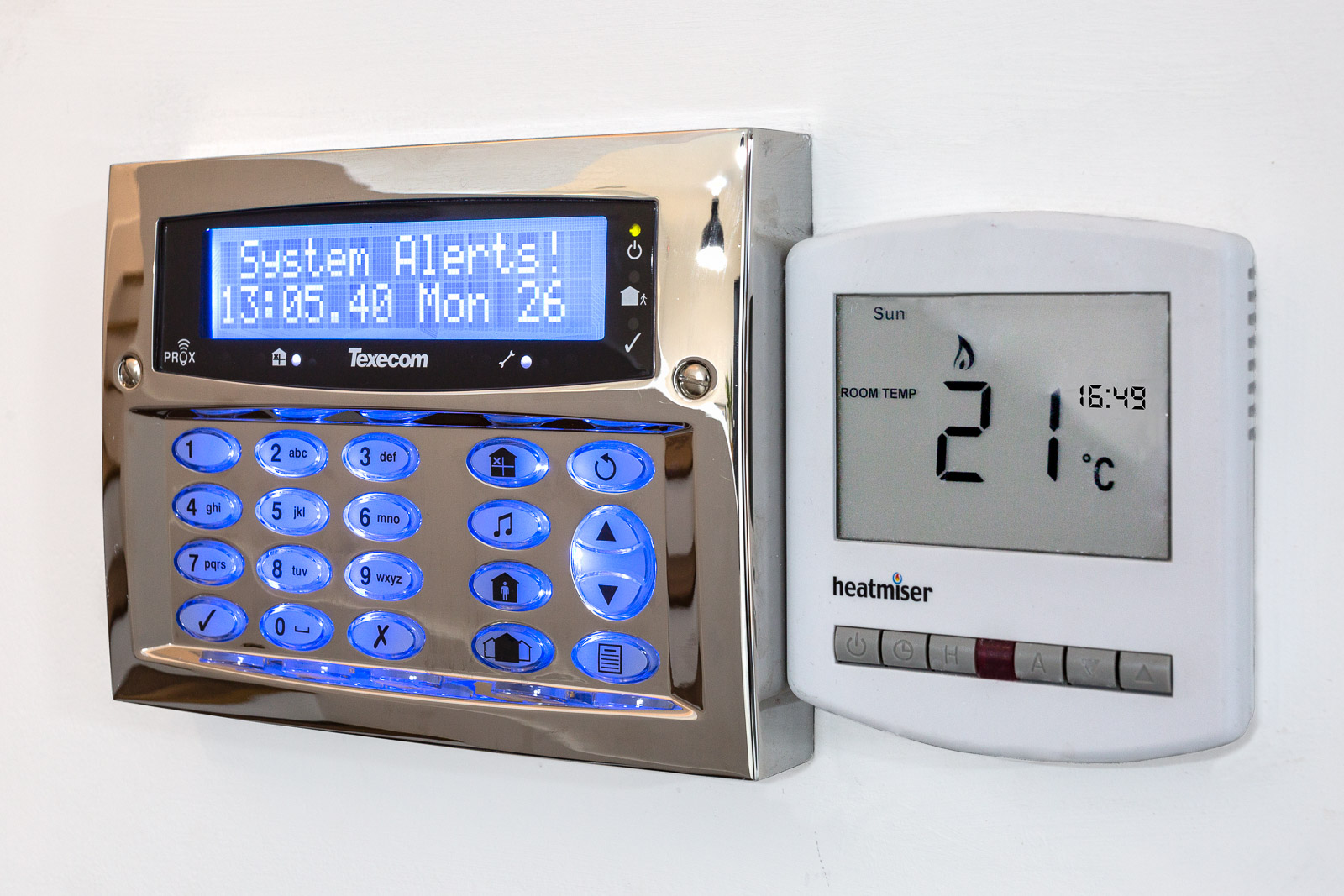 wall mounted control panel for modern house features such as heating, intruder alarm and entertainment systems