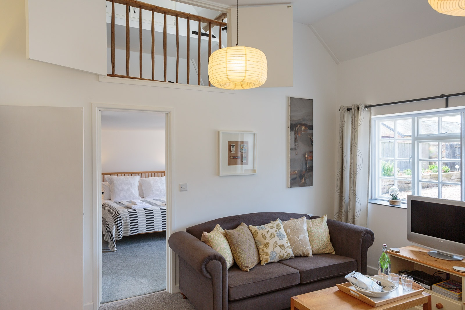 Compact bed and breakfast accommodation looking from lounge area into ground and mezzanine floor bedrooms