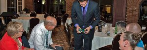 Magician Steven Brundage performing up-close magic at a private event