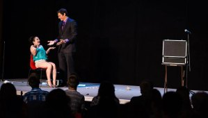 Magician Steven Brundage performing stage magic at a college