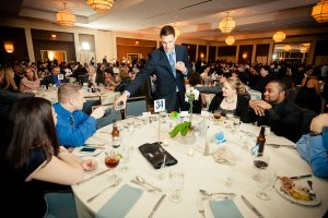 Magician Steven Brundage performing up-close magic at a corporate event
