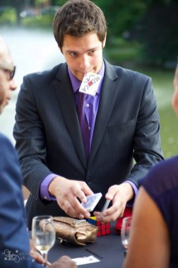 Magician Steven Brundage performing a card trick