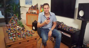 Magician Steven Brundage poses with his signature Rubik's Cube