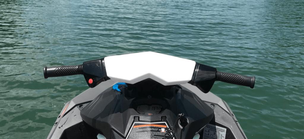 riding jet ski on the lake