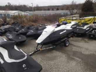 Lot of jet skis with covers on them