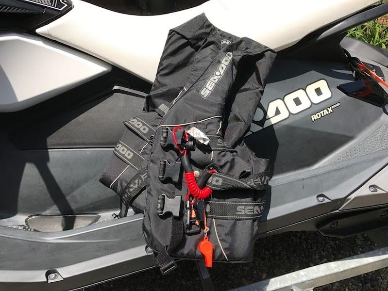 showing off jet ski life vest
