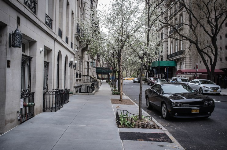 American Muscle car, a Dodge Challenger waits outside 5th Avenue Synagogue