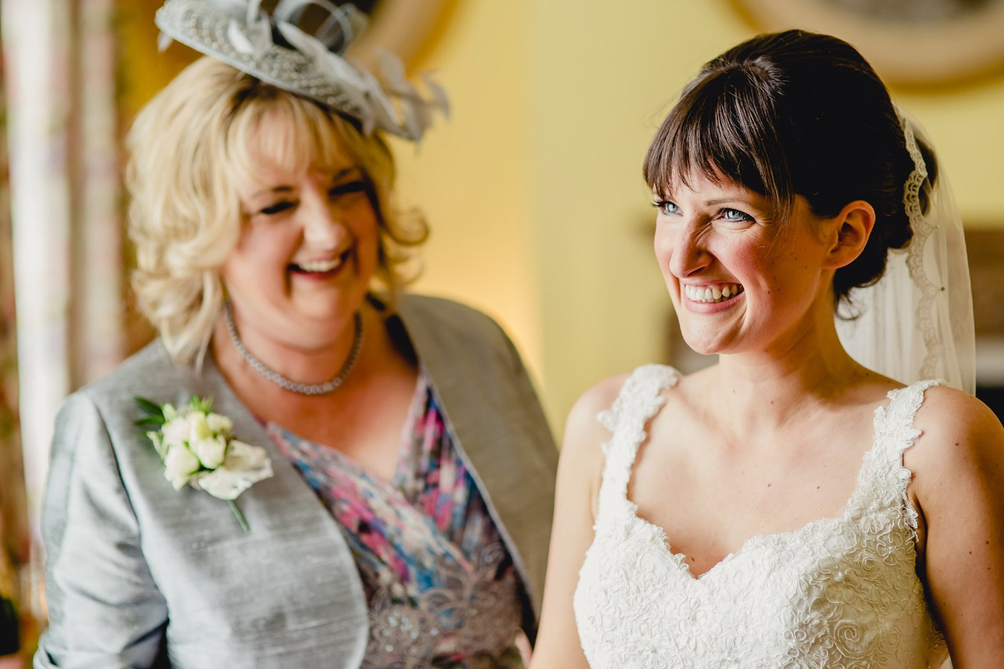 jess with her mum looking on before the wedding service at capesthorne hall