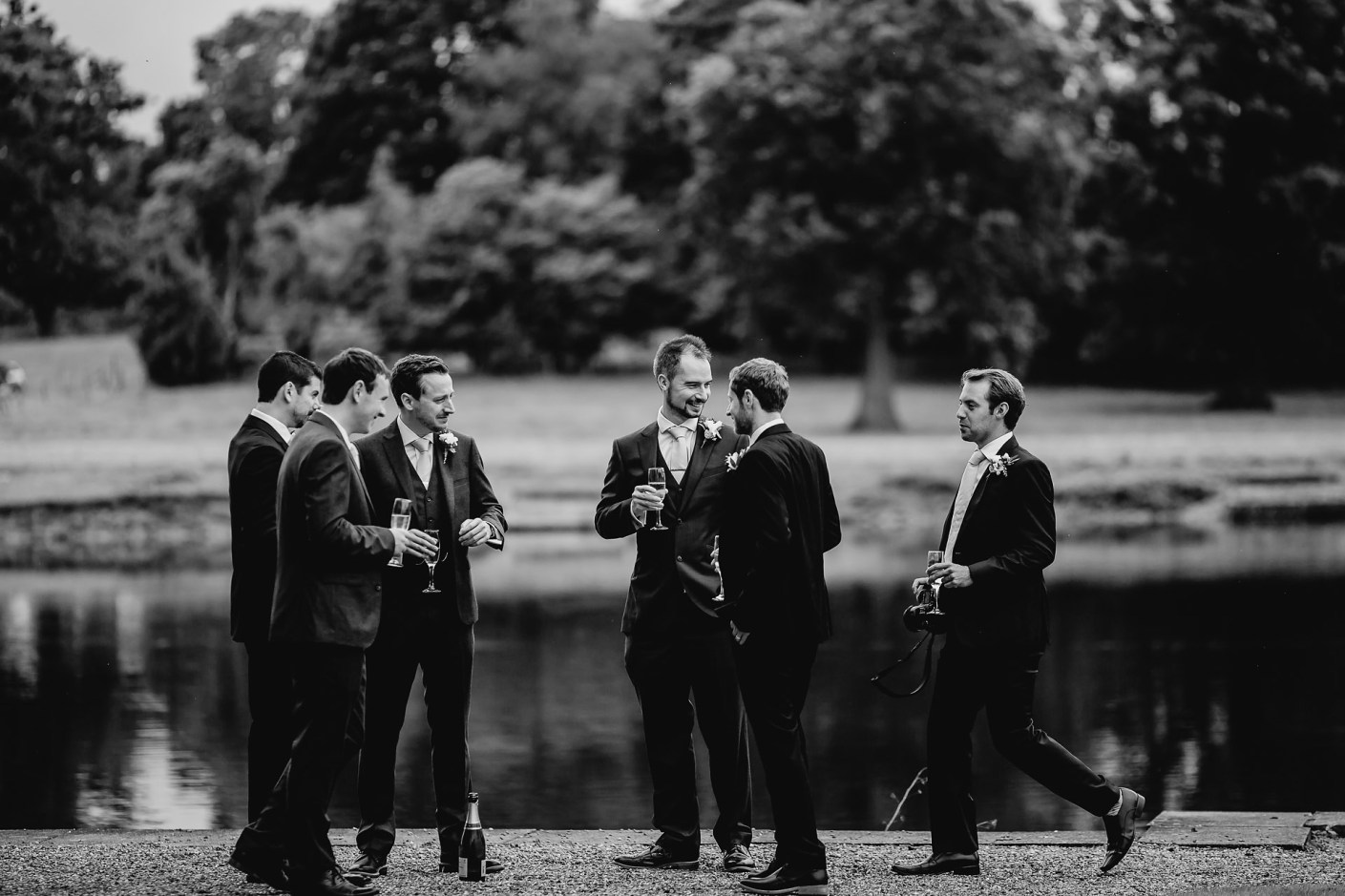 groomsmen getting ready by the lake- capesthorne - hall