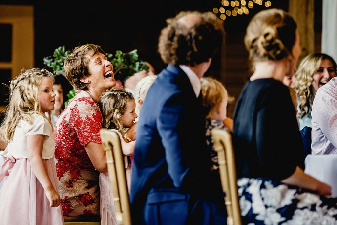 mother of the groom laughing