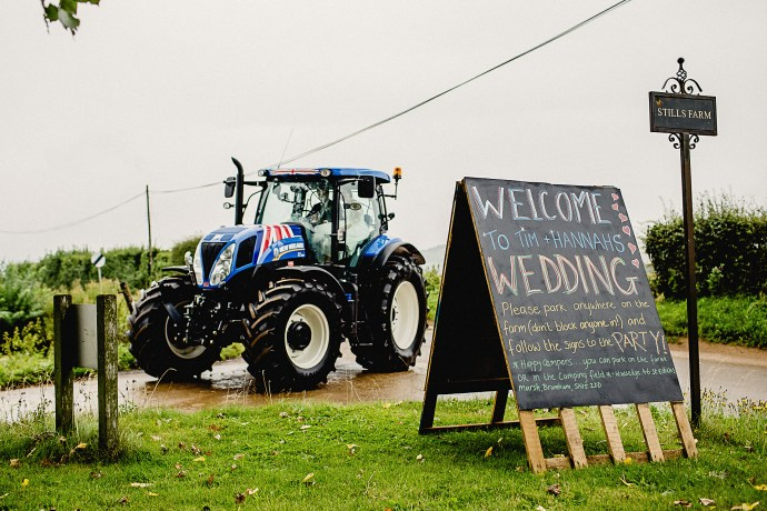 arriving at the wedding in a tractor