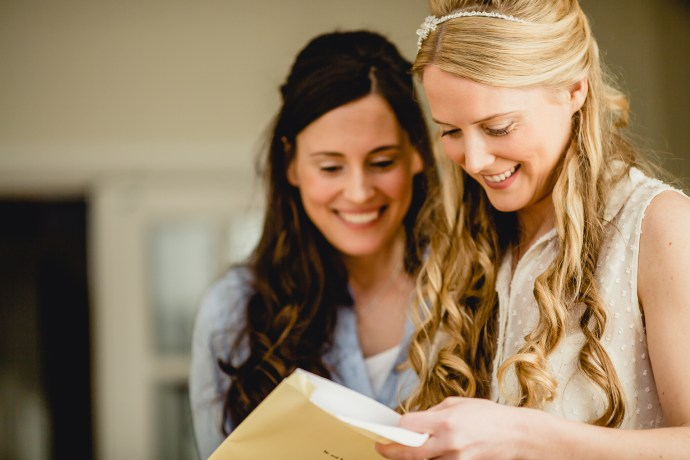 a bride and her sister sharing a moment before the wedding