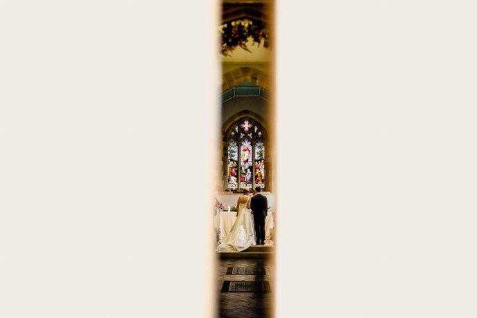 photo through the door of the church down the aisle