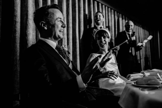 groom reacting during the best man speech