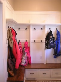 built in mudroom with foot lockers, coat hangers, and overhead storage