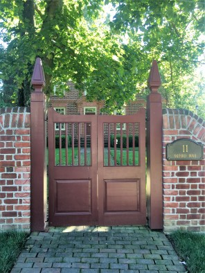 Man gate and Newel posts that have been restored