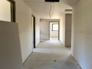 Wider hallways, additional office space (left side of hall)