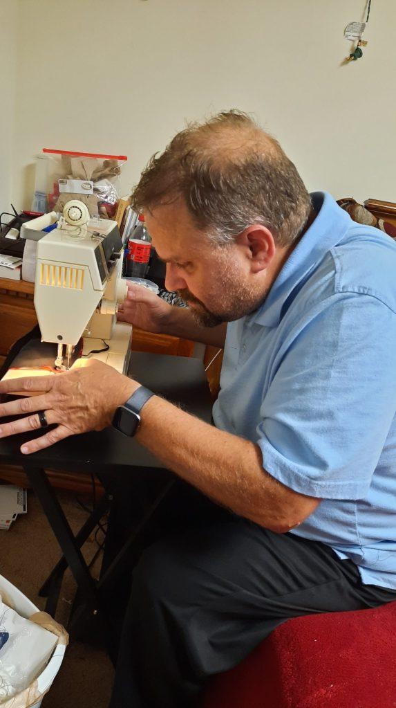 Steve sewing face masks
