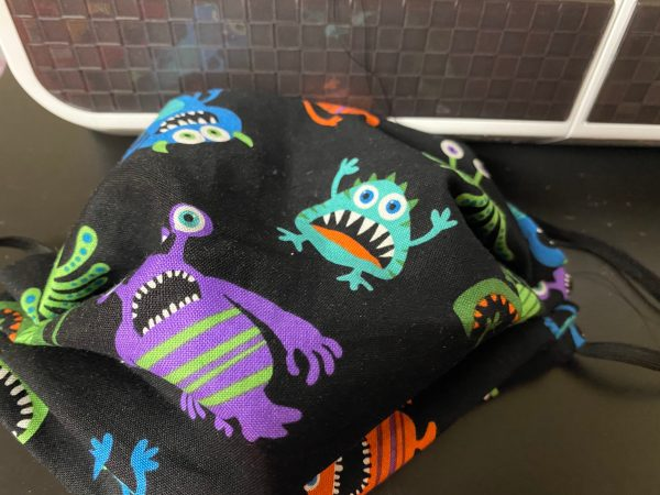 Monsters Face mask - a face mask with colorful monsters on it. #Monsters