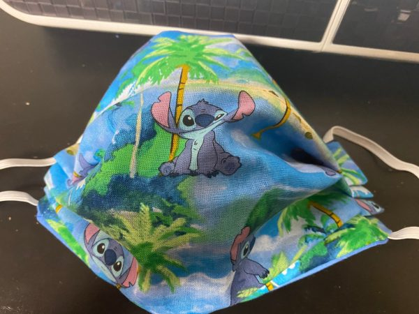 Stitch Face Mask - A Hawaiian theme with Stitch and palm trees on the face mask. #Stitch