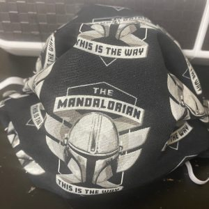 "Mandalorian Helmet Face Mask - This Star Wars Mandalorian face mask has Mondo's helmet on it and the words ""This is the Way"" on it. #Mandalorian"