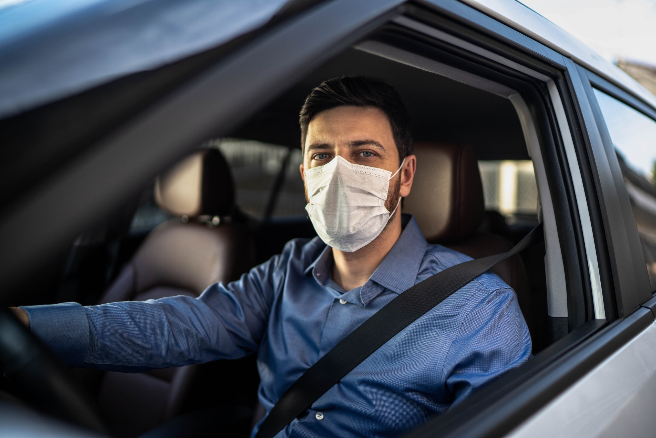 Slammed for wearing a face mask in car alone
