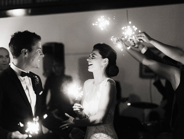 bride and groom with wedding sparklers
