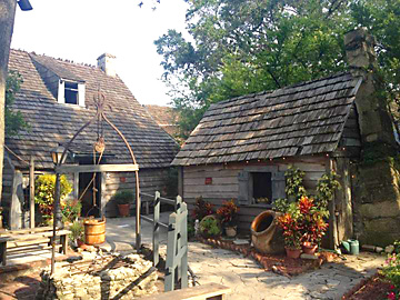 Oldest Wooden School House outbuildings and tropiical gardens