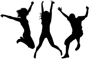Silhouetted figures jumping for joy