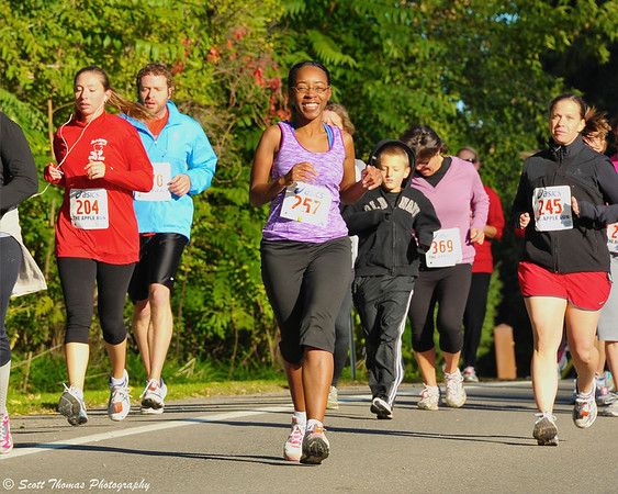 Runners enjoying a beautiful Fall day during the Apple Run 5K Road Race at the LaFayette Apple Festival.