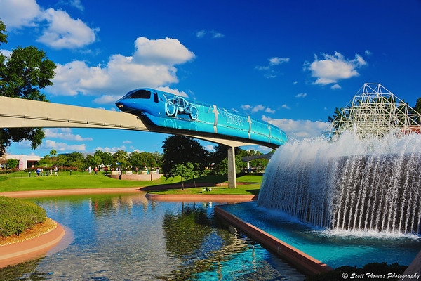 The TRON monorail moves past the reverse waterfall in front of the Journey Into Imagination pavilion in Epcot's Future World.