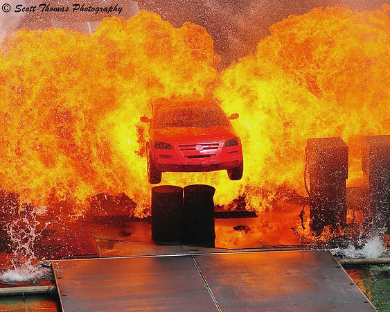 The Hero car jumps thru fire in the finale of the Light, Motors, Action Extreme Stunt Show in Disney's Hollywood Studios.