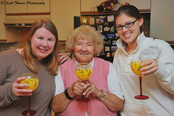 Mom with her granddaughters enjoying a mimosa cocktail on Christmas morning.
