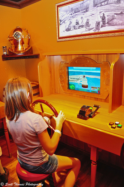 A young sailor plays a computer simulation game in the Oceaneer's Club on Deck 5 of the Disney Dream.