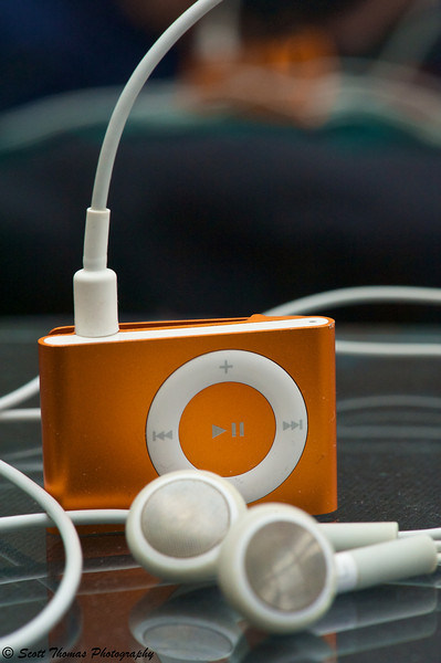 My exercise partner, an Orange Ipod Shuffle taken with a Nikon 105mm f/2.8 VR Micro (Macro) lens.