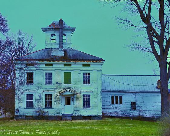 Green light on an old farm house near Baldwinsville, New York.