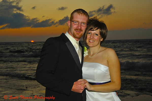 Newly married Jeff and Kelly make a happy foreground to a beautiful Lake Ontario sunset at Bayshore Grove, Oswego, New York.
