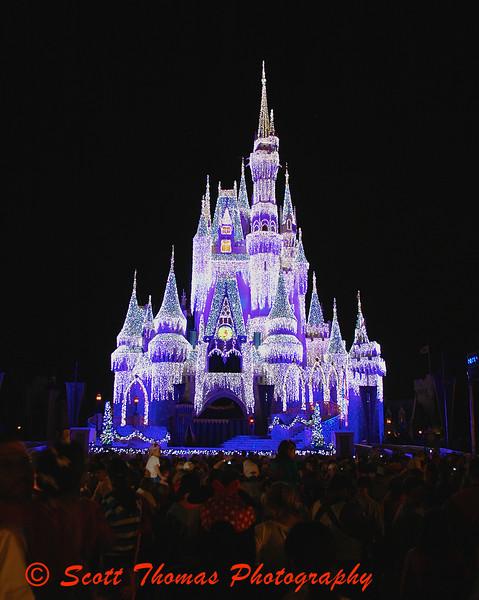 Cinderella Castle Dream Lights during the Christmas holidays at the Magic Kingdom in Walt Disney World, Orlando, Florida.