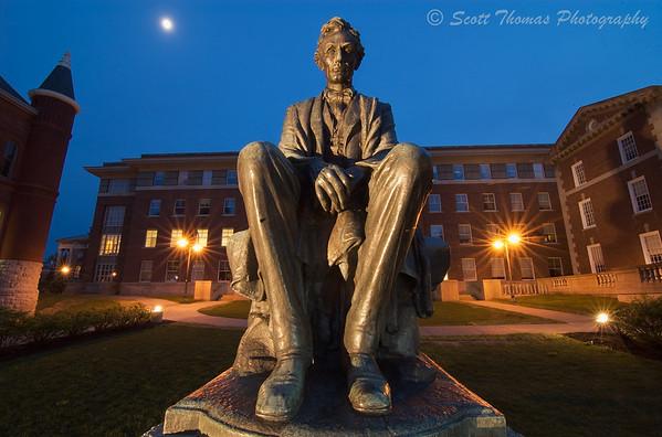 A long exposure night photo of the Lincoln statue on the Syracuse University campus using a wide angle lens.