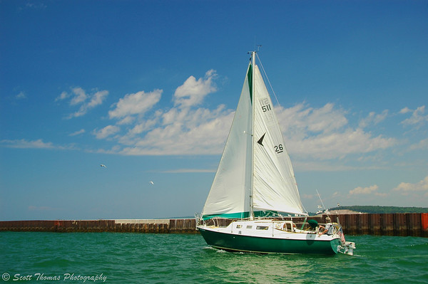 Sailboat heading to Lake Ontario from the Fair Haven Beach New York State Park.