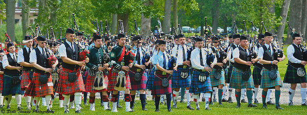Bagpipers from several Piping bands take part in the Massed Band during the Opening Ceremonies at the CNY Scottish Games at Long Branch Park in Liverpool, New York, on Saturday, August 14, 2010.