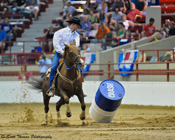 Crash!  A barrel is knocked over which will result in a time penalty for the rider.