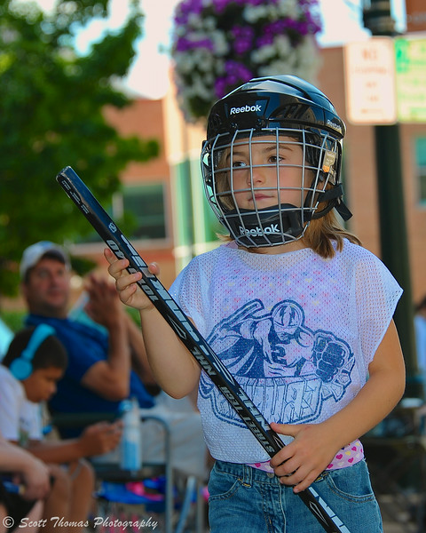 A young girl getting ready for her time in the Street Crunch hockey game outside the War Memorial Arena in Syracuse, New York on Saturday, July 26, 2014.