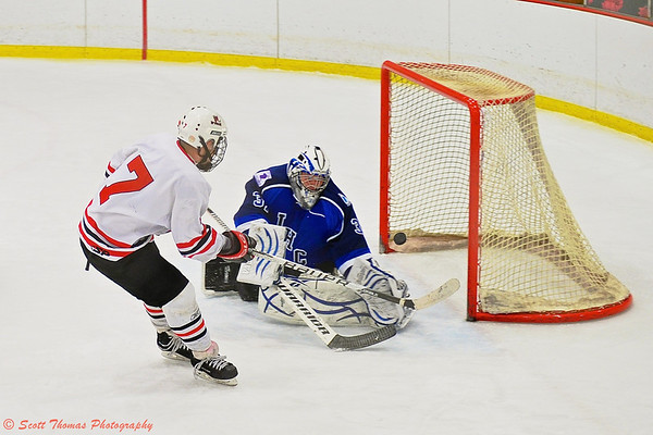 Baldwinsville Bees Parker Ferrigan (7) nets a shorthanded goal against the Watertown IHC Cavaliers goalie Grant Chamberlain (31).
