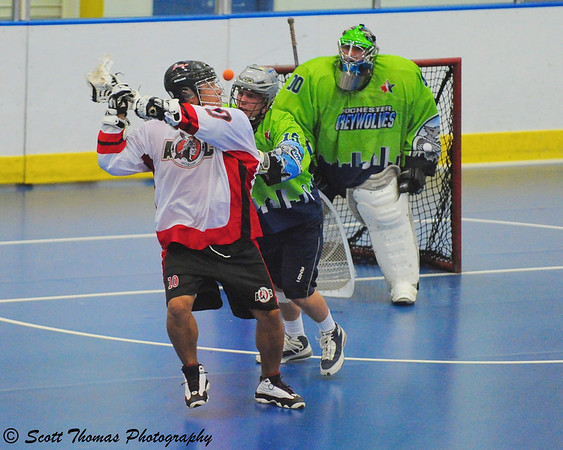 Anticipating the play like this over the shoulder shot by a lacrosse player is part of a sports photographers learned skill.