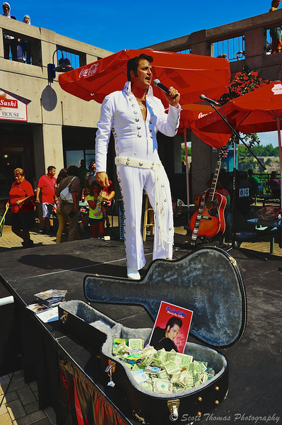 Roy LeBlanc, an Elvis impersonator, entertains people in the Maid of the Mist Marketplace at Niagara Falls in Ontario, Canada.
