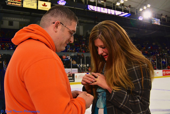 Newly engaged woman at the Syracuse Crunch game in the Onondaga County War Memorial on Saturday, December 14, 2013.