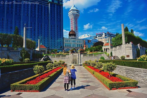 Tourists stop to photograph the Casino Niagara behind Queen Victoria park at Niagara Falls in Ontario, Canada.